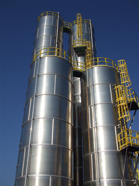 Custom Fiberglass Ladders with Cages and rest platforms on Stainless Storage Tanks