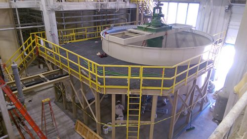 Fiberglass Structural Platform, and pipe support around process settling tank.